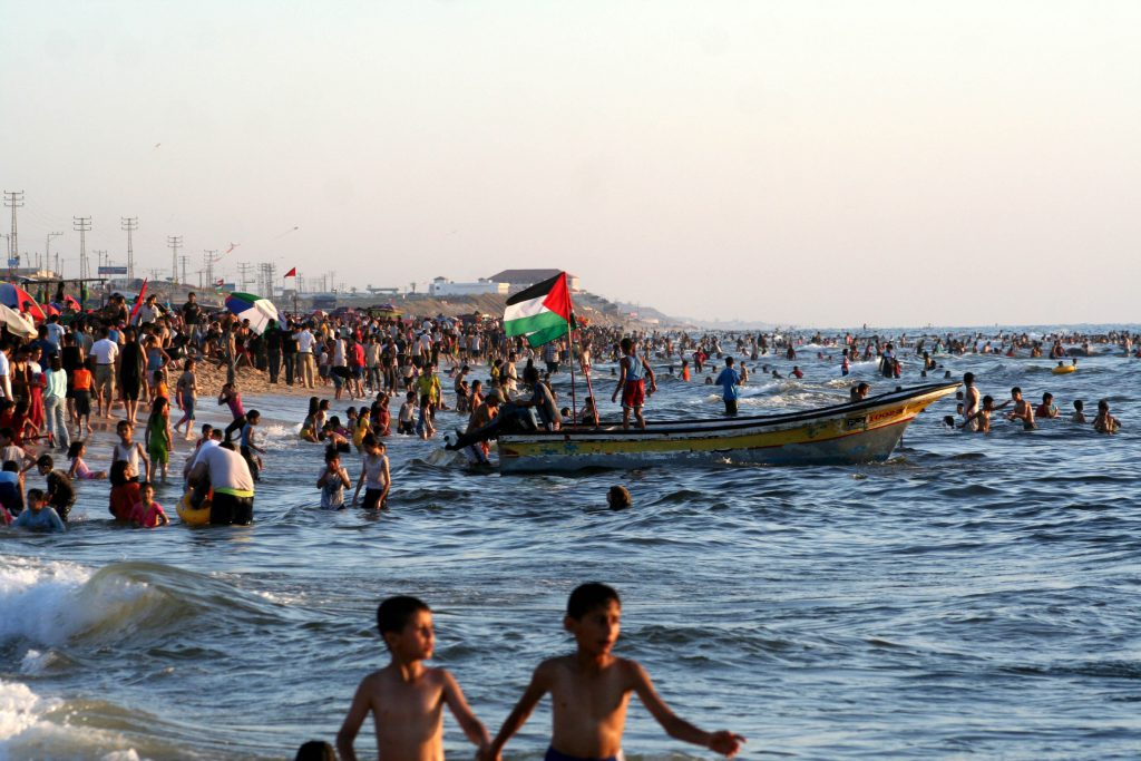 Palestinians enjoy a day at the beach in Gaza city following a truce between Israel and Hamas.