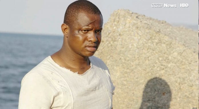 Nigerian migrant Don Emeka claims to have been assaulted with ax by Black Ax members when he did not want to be part of their criminal activity. (Photo: The Vice, screenshot)